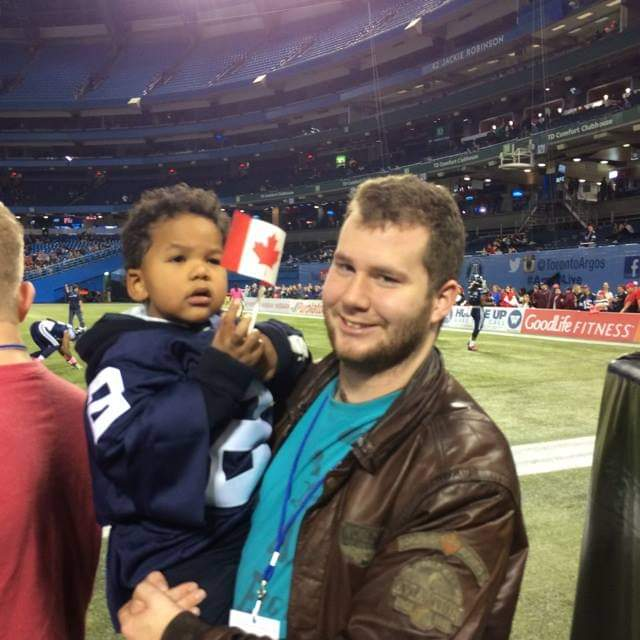 Lt. Niles and his little brother at an Argos game